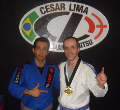 Rodger with his instructor Cesar Lima celebrating success after they both won gold at the 2011 European BJJ open.